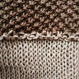 Stiches in tricot in sand colors Royalty Free Stock Images