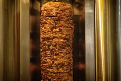Meat cuts prepared Shawarma. A stick of Arab shwarma in front of the grill, a popular Middle Eastern snack Stock Photos