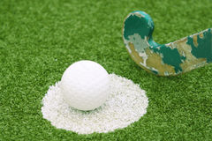 Stick and ball. On a green grass Royalty Free Stock Photo