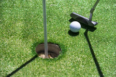 Stick with a ball on an artificial golf Stock Photography