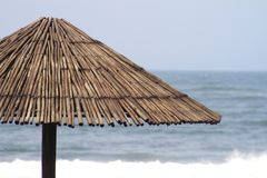 Stick Beach Umbrella against Indian Ocean Stock Photography