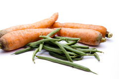 Stick beans and carrots. On white background Stock Images
