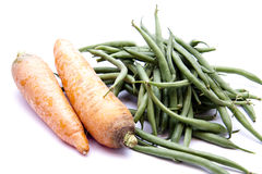 Stick beans and carrots. On white background Stock Photography