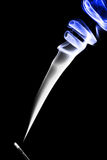Stick with a blue smoke. Royalty Free Stock Photos