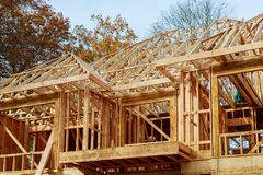 A stick built house under construction New build roof with wooden and beam framework. A stick built house under construction New build roof with wooden truss stock images