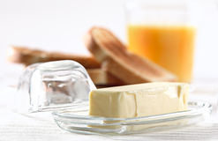Stick of butter at breakfast Stock Photography