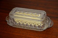 Stick of butter in butter dish Royalty Free Stock Photo