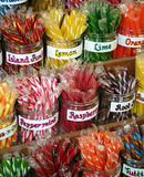 Stick Candy. Brightly colored stick candy in clear, glass jars Stock Photos