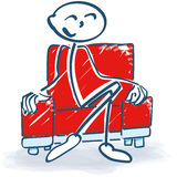 Stick figure with in a armchair. Stick figure relaxing in a armchair Royalty Free Stock Image