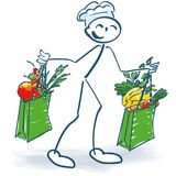 Stick figure as a cook with two shopping bags full of vegetables. Stick figure as a cook with two shopping bags full of healthy vegetables Royalty Free Stock Photo
