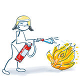 Stick figure as firefighter with a fire extinguishe Stock Photos
