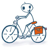 Stick figure with a bicycle Stock Image
