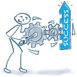 Stick figure with boost the success with gears Royalty Free Stock Photo