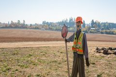 Stick figure decorated as a construction worker. Roloff Farm, OR / USA - October 21 2018: Stick figure decorated as a construction worker with a `SLOW` sign in stock photo