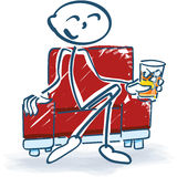 Stick figure with a drink in an armchair. And relax royalty free stock images