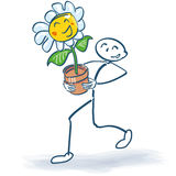 Stick figure with a flower in flowerpot. And gardening Royalty Free Stock Photos