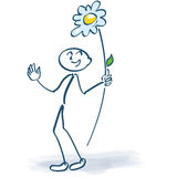 Stick figure with a flower lolly. Stick figure with a nice flower lolly Royalty Free Stock Images