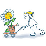 Stick figure with a flower on the sackcloth. Stick figure with a big flower on the sackcloth Royalty Free Stock Image