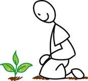 Stick figure gardener planting royalty free stock photography