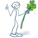 Stick figure with green shamrock and finger pointer. In the air royalty free illustration