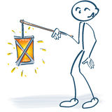 Stick figure with a lantern. And Saint Martin Stock Photography