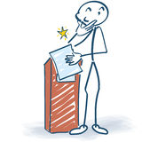Stick figure at the lectern Stock Photography