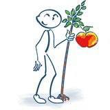 Stick figure with a little apple tree Royalty Free Stock Photo