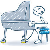 Stick figure at the piano and music Stock Photo