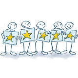 Stick figure with posters and five stars Stock Photo
