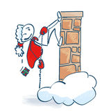 Stick figure Santa goes high at the stone Stock Images