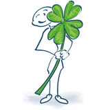 Stick figure with shamrock Stock Image