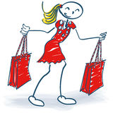 Stick figure with shopping bags during shopping. Stick figure with two shopping bags during shopping Stock Image