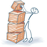 Stick figure and stacked packages Royalty Free Stock Image