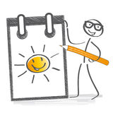 Stick figure thinking positive. Optimistic stick figure drawing a sun in a notebook stock illustration