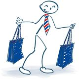 Stick figure with two shopping bags while shopping. And having fun Royalty Free Stock Photo