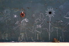 Stick figure on wall. Stick figure sketches on a wall royalty free stock photo