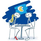 Stick figures as lovers at the table in the night. Stick figures having dinner as lovers at the table in the night Stock Image