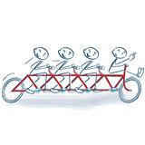 Stick figures and cycling as a group. On a bike Royalty Free Stock Photos