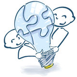 Stick figures with light bulb as a puzzle. And team spirit Royalty Free Stock Photo