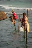 Stick fishermen in Unawatuna, Sri Lanka Stock Images