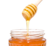 Stick with honey and jar. Stick with honey  on white Royalty Free Stock Photo