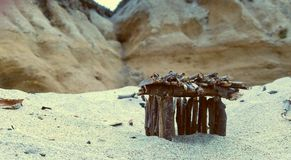 Stick house with cliffside view Royalty Free Stock Image