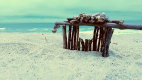 Stick house over looking pacific ocean Stock Photography