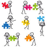Stick man stick figure jigsaw puzzle. Set of vector stick figures: Stickman holding colorful jigsaw puzzle pieces Royalty Free Stock Images