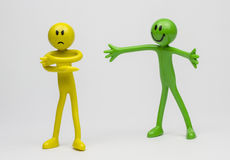 Stick men busines quarrel. Plastic stick men representing work , corporate or people . One unhappy/bad communication and  one with positive attitude Royalty Free Stock Photo
