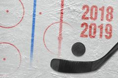 Stick, puck and hockey arena fragment with markings. Hockey stick, puck and hockey arena with markings. Concept, hockey, background, season royalty free stock photography
