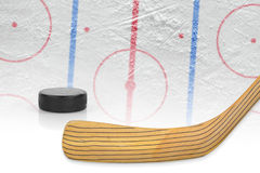 Stick, puck and hockey field Stock Photos