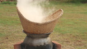 Stick rice boil steam in weaving bamboo and pot. stock video