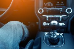 Stick Shift Driver. Driver in the Modern Compact Car with Manual Transmission Royalty Free Stock Photos