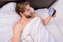 Stick sleep schedule same bedtime and wake up time. Man sleepy drowsy unshaven bearded face covered with blanket having. Rest. Sleep regime habits concept. Man royalty free stock photos